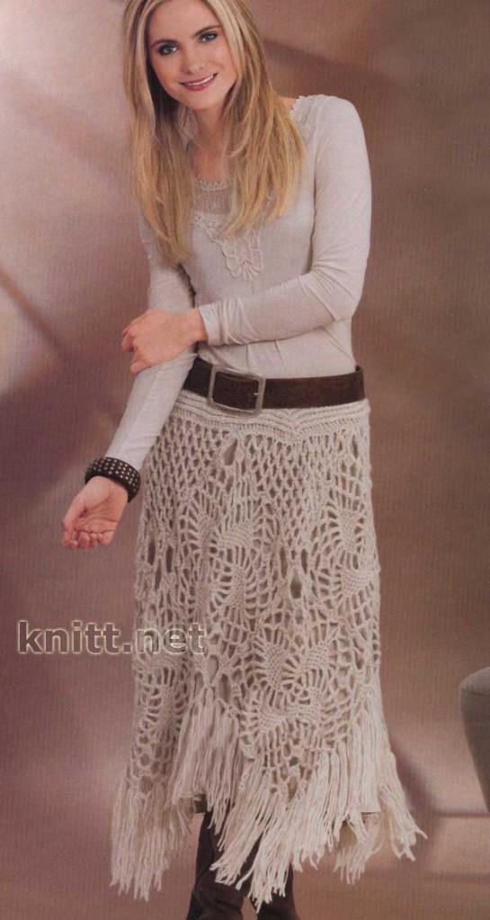 Ажурная юбка связана крючком из мотивов.  Модель украшена по низу...