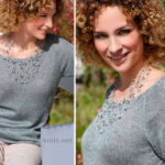 Вязаный пуловер с ажурными вставками на рукавах