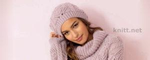 Вязаная розовая шапка с ажурным узором